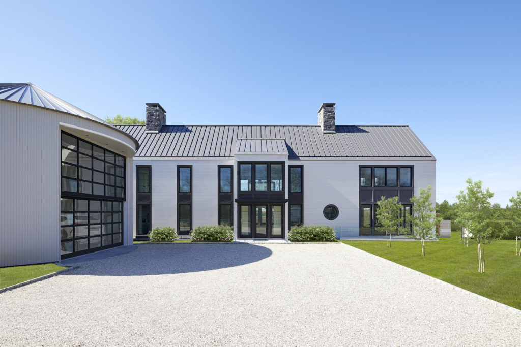 Entry of modern farmhouse in Sagaponack, New York featuring custom TruExterior siding by Duration Moulding & Millwork